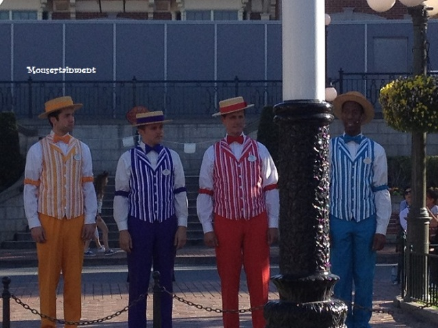 The Dapper Dans of Disneyland in front of the flagpole in Town Square at Flag Retreat.