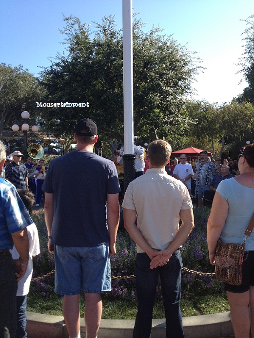 Current military and veterans surround the flagpole in Town Square.